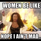Kép: Nő pózol mögötte égő autóval. Felirat: Women be like nope I ain't mad.
